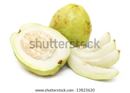 Half guava and slices with the complete one on white background.