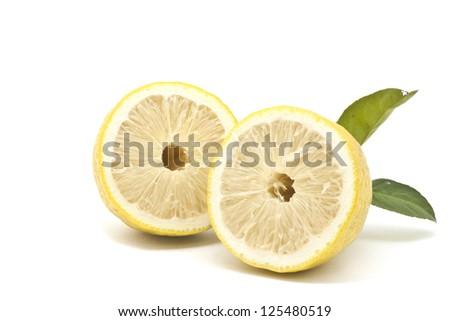 Half Japanese lemon isolated on white background - stock photo