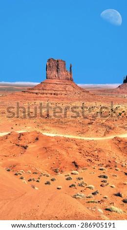 Half Large moon over Monument Valley Arizona - stock photo