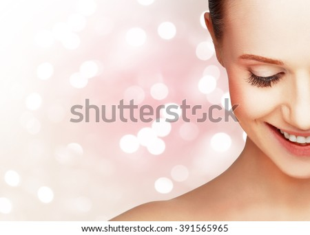 half laughing face of a beautiful healthy woman - stock photo