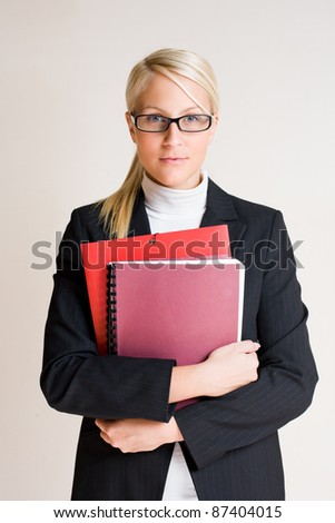 Half lenght portrait of tense looking young business woman. - stock photo