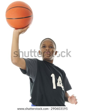 Half-length low angle image of a preteen boy attempting to make a one handed basketball shot.  On a white background. - stock photo