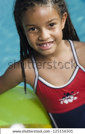 Half length of a young girl in bathing suit smiling - stock photo