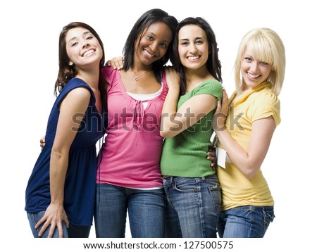 Half length of four young women hugging and smiling - stock photo