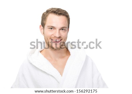 Half length of smiling man wearing white bathrobe