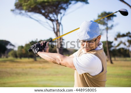 Half length of sportsman playing golf on a field - stock photo