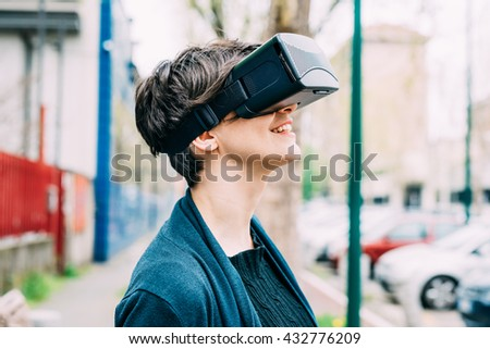 Half length of young beautiful caucasian business woman using 3D viewer - futuristic, technology concept - stock photo