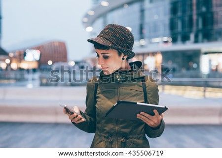 Half length of young handsome caucasian brown straight hair woman using smartphone and tablet, looking downward screen, smiling - multitasking, technology, social network concept concept - stock photo