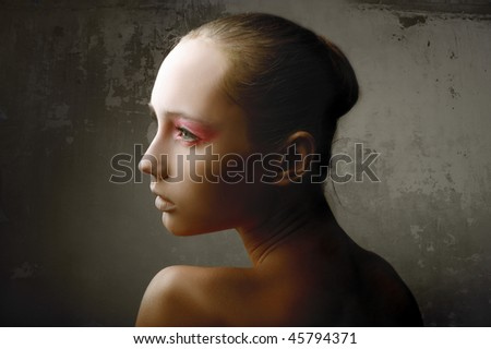 Half-length portrait of a beautiful woman with elegant makeup - stock photo