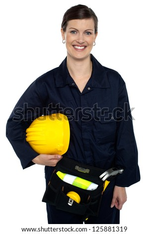 Half length portrait of a cheerful lady worker captured in a relaxed mood on white background. - stock photo