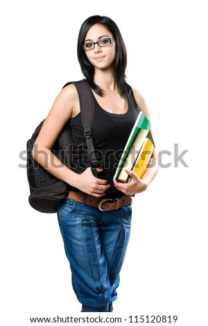 Half length portrait of a cute young student girl holding colorful exercise books. - stock photo