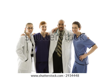 Half-length portrait of African-American man and Caucasian women medical healthcare workers in uniforms with arms around eachother standing against white background.
