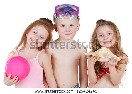 Half-length portrait of boy and two girls in beach suits, boy with swimming mask and girls with ball and seashell - stock photo