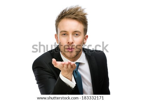 Half-length portrait of business man blowing kiss, isolated on white. Concept of love and affection - stock photo