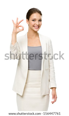 Half-length portrait of business woman ok gesturing, isolated on white. Concept of leadership and success - stock photo