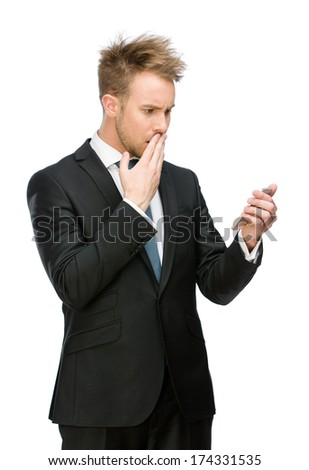 Half-length portrait of businessman looking at cell phone, isolated on white - stock photo