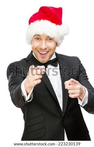 Half-length portrait of businessman wearing Santa Claus cap, isolated on white. Concept of holidays and Christmas - stock photo