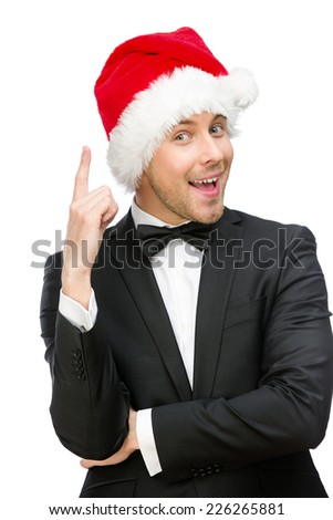 Half-length portrait of businessman wearing Santa Claus cap who attention gestures, isolated on white. Concept of holidays and Christmas - stock photo