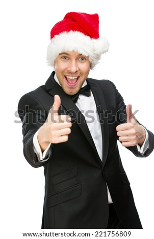Half-length portrait of businessman wearing Santa Claus cap who thumbs up, isolated on white. Concept of holidays and Christmas - stock photo