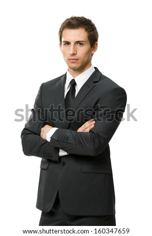 Half-length portrait of businessman with crossed hands, isolated. Concept of leadership and success