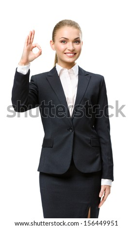 Half-length portrait of businesswoman okay gesturing, isolated on white. Concept of leadership and success - stock photo