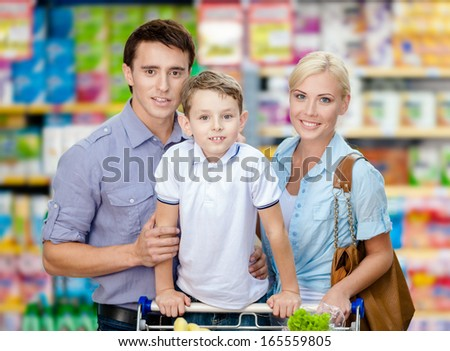 Half-length portrait of family in the store. Concept of consumerism and family relations