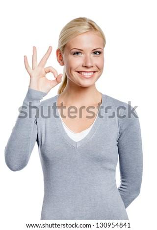 Half-length portrait of female okay gesturing, isolated on white - stock photo