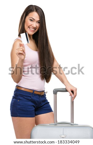 Half-length portrait of female tourist with travel suitcase and credit card, isolated on white - stock photo