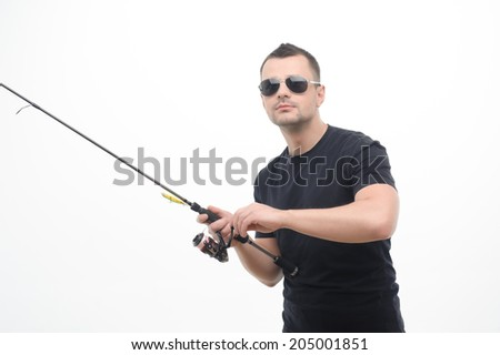 Half-length portrait of handsome fisherman wearing eyeglasses concentrated on the fishing. Isolated on white background - stock photo