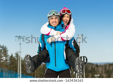 Half-length portrait of happy couple of skiers have fun. Concept of winter sports and cute vacations - stock photo