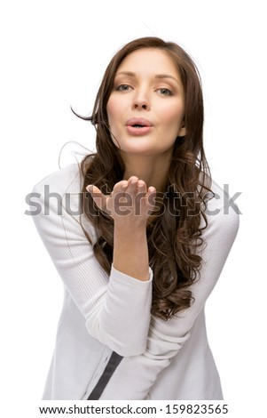 Half-length portrait of lady blowing kiss, isolated on white. Concept of love and affection - stock photo