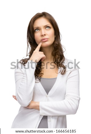 Half-length portrait of pensive female touching her face, isolated on white
