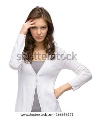 Half-length portrait of pensive young woman touching her face, isolated on white - stock photo
