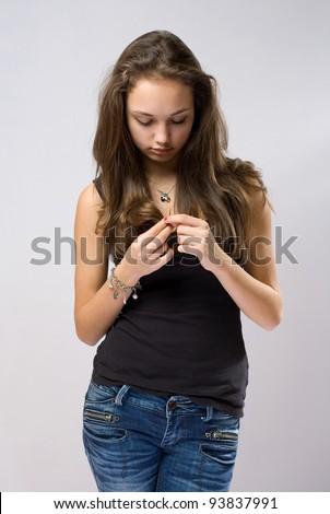 Half length portrait of sad young emotional brunette. - stock photo