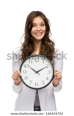 Half-length portrait of woman holding clock, isolated on white - stock photo