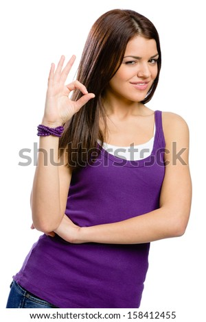 Half-length portrait of woman with okay gesture, isolated on white - stock photo