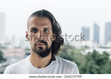 Half long, half short haired beautiful young man. Life decisions.  - stock photo