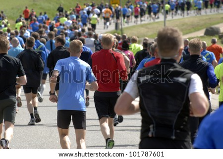 Half marathon event with 11000 runners - stock photo