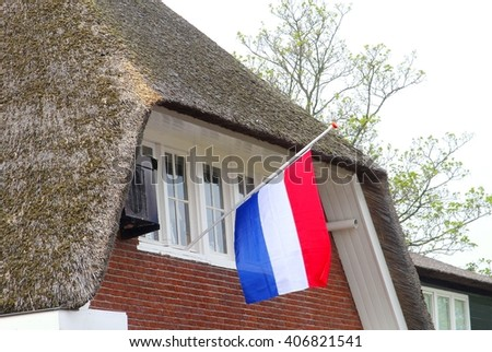 Half mast Dutch flag at a house on Commemoration Day for the remembrance of the Dutch people who have died in wars since the start of World War two, Netherlands. Each year on May 4 in the Netherlands  - stock photo