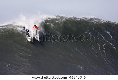 HALF MOON BAY, CA - FEBRUARY 13: Carlos Burle and Chris Bertish bump in the 2009/2010 Mavericks Surf Contest February 13, 2010 in Half Moon Bay, California - stock photo