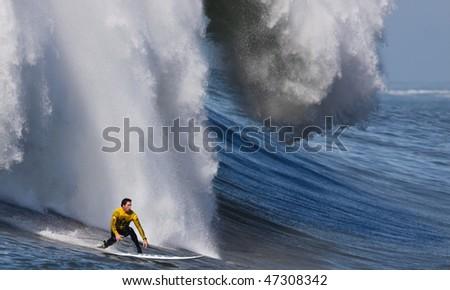 "HALF MOON BAY, CA - FEBRUARY 13: Kenny ""Skindog"" Collins rides a monster wave in the 2009/2010 Mavericks Surf Contest February 13, 2010 in Half Moon Bay, California. - stock photo"