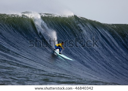 HALF MOON BAY, CA - FEBRUARY 13: Shane Desmond catches a wave in the 2009/2010 Mavericks Surf Contest February 13, 2010 in Half Moon Bay, California