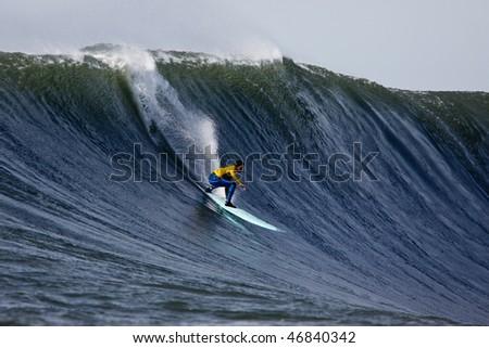 HALF MOON BAY, CA - FEBRUARY 13: Shane Desmond catches a wave in the 2009/2010 Mavericks Surf Contest February 13, 2010 in Half Moon Bay, California - stock photo