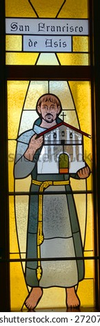 HALF MOON BAY CA USA APRIL 12: San Francisco De Asis (Saint Francis of Assisi) stained glass window in Our Lady of the Pillar Church on april 12 2015 in Half Moon Bay, CA,  - stock photo
