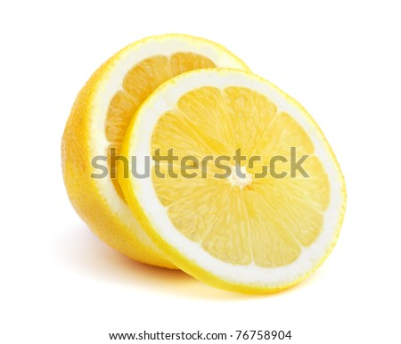 Half of a lemon with one slice isolated on white background - stock photo