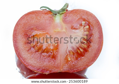 half of a red tomato