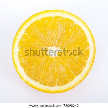 Half of a ripe orange on white background - stock photo