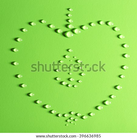 Half of apple made of water drops on green background - stock photo