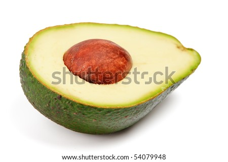 Half of avocado with pit isolated on white background - stock photo