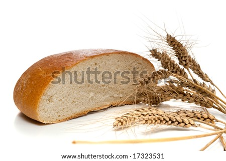 Half of bread loaf and wheat spikes, isolated, on white background - stock photo